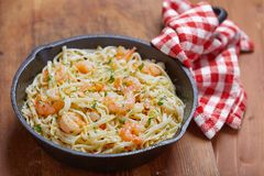 Shrimp Scampi. Pasta with Shrimp Scampi in a pan Stock Photo