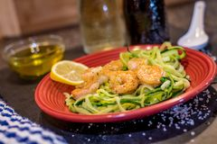 Shrimp Scampi served over zucchini noodles sauteed with lemon, garlic, butter and herbs. Shrimp Scampi served over zucchini noodles zoodles sauteed with lemon Royalty Free Stock Image