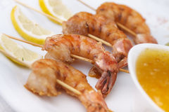 Shrimp Scampi Skeweres with Souce Stock Photo