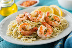 Shrimp Scampi with Spaghetti. A delicious plate of shrimp scampi with spaghetti and lemon Royalty Free Stock Images