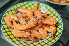 Shrimp seafood prawns dinner meal cooking home kitchen plate dish stove Stock Photography