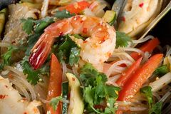 Shrimp, seafood, vegetables and rice noodles Stock Photos