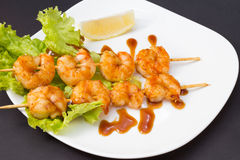 Shrimp shashlik isolated on lack background Stock Image