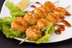 Shrimp shashlik on black background Stock Photography