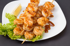 Shrimp shashlik isolated on lack background Royalty Free Stock Images