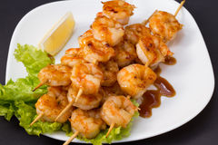 Shrimp shashlik isolated on lack background Stock Photo