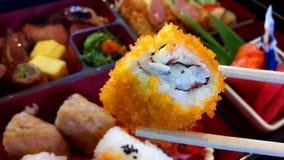 Shrimp with shrimp eggs Sushi food. Sushi with egg, shrimp, sushi, Japanese food on wooden chopsticks ready to eat Stock Photos