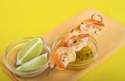 Shrimp skewer. With butter dip royalty free stock photos