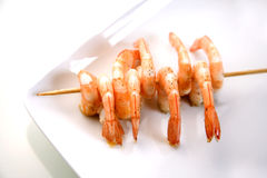 Shrimp skewers. On white Royalty Free Stock Photos