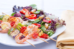 Shrimp skewers with fresh mixed salad Stock Photos