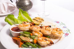 Shrimp Skewers are Grilled and Served with Veggies and Rice Royalty Free Stock Images