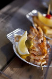 Shrimp skewers and lemon Royalty Free Stock Images