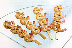 Shrimp skewers served on plate Royalty Free Stock Photos