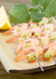 Shrimp on skewers with wasabi sauce Stock Image