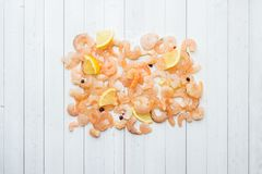 Shrimp with spices and lemon on the table.  royalty free stock images