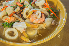 Shrimp and squid food. On the brown dish Stock Photography