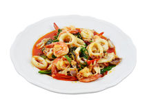 Shrimp and squid stir-fried peppers and basil. Royalty Free Stock Image