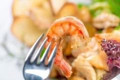 Shrimp sticking on fork Stock Photo
