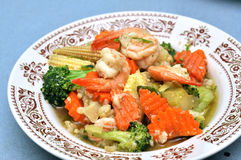 Shrimp Stir Fry. With vegetables, carrots, peas, broccoli, onions, and garlic sauce Stock Photos