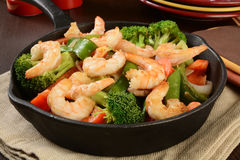 Shrimp stir fry. In a cast iron skillet Royalty Free Stock Photo