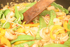 Shrimp stirfry with spoon Royalty Free Stock Images