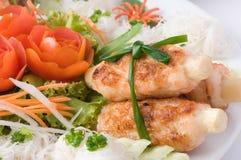 Shrimp and sugarcane. On white plate Stock Photography
