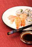 Shrimp sushi and California rolls Stock Images
