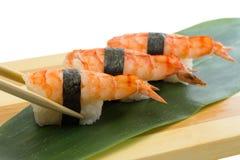 Shrimp sushi nigiri on wooden plate isolated on white background Royalty Free Stock Images
