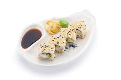 Shrimp sushi roll with ginger wasabi and soy sauce on a white plate Stock Photography