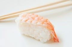 Shrimp sushis and chopsticks Stock Photo