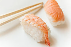 Shrimp sushis and chopsticks Stock Images