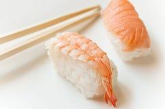 Shrimp sushis and chopsticks Stock Images