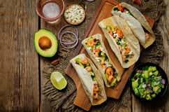 Shrimp tacos with avocado salsa royalty free stock images