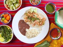 Shrimp tacos rice and frijoles Mexican style Stock Photos