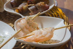 Shrimp tapas on sticks. Tapas on sticks in a restaurant. Mallorca, Balearic islands, Spain Stock Photo