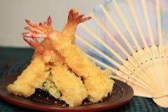 Shrimp tempura. With hand fan Stock Photos