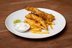 Shrimp tempura dish with white sauce and fried potatoes Royalty Free Stock Photo