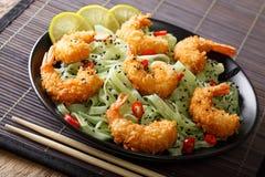 Shrimp tempura with green tea pasta, chili and sesame close-up o royalty free stock photos