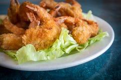 Shrimp Tempura. Large serving of popcorn shrimp tempura appetizer on bed of lettuce Royalty Free Stock Photo