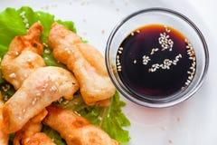 Shrimp tempura with lettuce and sesame seeds Royalty Free Stock Photos