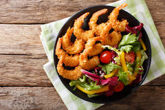 Shrimp tempura and salad of fresh vegetables close-up on a plate Stock Photography