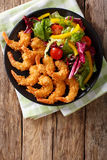 Shrimp tempura and salad of fresh vegetables close-up on a plate Stock Photo