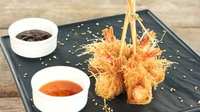 Shrimp tempura and sauce. Seafood appetizer on a plate stock footage