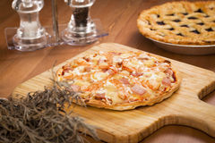 Shrimp Thin Crust Pizza_2013-2. Shrimp Thin Crust Pizza on a desk Royalty Free Stock Photography