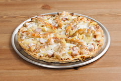 Shrimp Thin Crust Pizza_2013-5. Shrimp Thin Crust Pizza on a desk Royalty Free Stock Photography