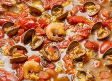 Shrimp in a tomato sauce with mollusks. Italian cuisine. seafood closeup view. stock images