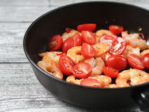 Shrimp and tomatoes in a pan Royalty Free Stock Image