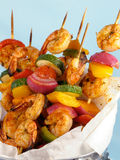 Shrimp & Vegetable Kebabs. Shrimp kebabs with colorful bell peppers, red onions, and cherry tomatoes, served in a metal bucket royalty free stock photos