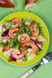 Shrimp and white bean salad. View from above, top studio shot. Royalty Free Stock Image