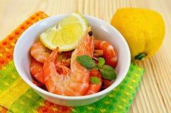 Shrimp in a white bowl with lemon Stock Photo